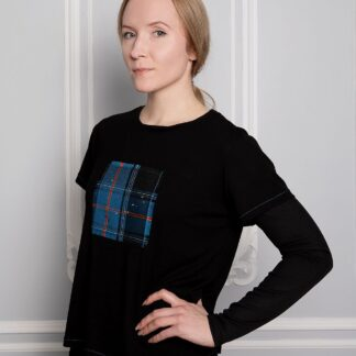 Woman wearing a Tartan T-shirt