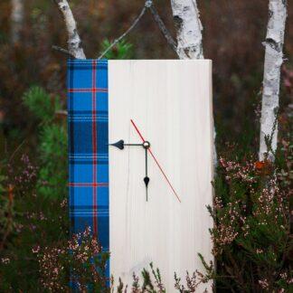 Wooden clock Estonian tartan in a bog